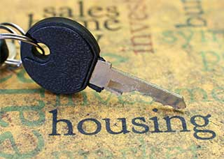 Image of a key over the word housing