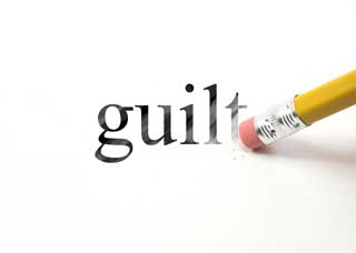 Image of a pencil erasing the word guilt