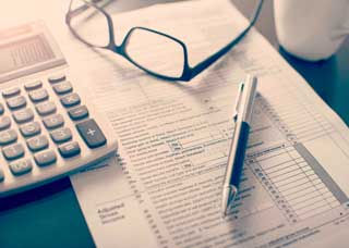 Image a calculator and tax forms