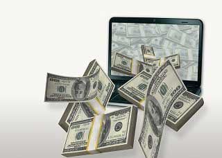 Image of money coming out of the screen of a computer