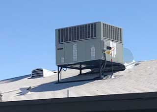 Air conditioner on house